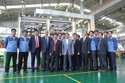 A group photo with the Dawonsys team in front of the AC/DC converter prototype. (Click to view larger version...)